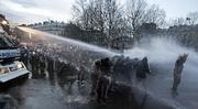 Police use water cannons to disperse protesters in Place de la Republique after a march against a job contract law in Paris. More than 1 million demonstrators protested across France on Tuesday.