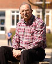 Lawrence resident Fred McElhenie, a semiretired researcher and writer, has written a book about the history of Kansas University housing.