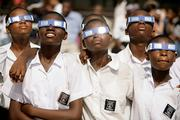 A group of schoolchildren look at the solar eclipse in Accra, Ghana. The students cheered Wednesday as the first total eclipse in years plunged Ghana into daytime darkness, an eagerly awaited solar show that swept northeast from Brazil to Mongolia.