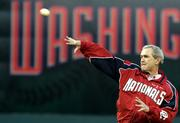 President Bush throws out the first pitch prior to the Washington Nationals home opener in this April 14, 2005 file photo. The White House has not said whether Bush would do the honors this year at the Nationals' home opener April 11.