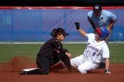 Jayhawk Destiny Frankenstein attempts to steal second base but Oklahoma State shortstop Krystle Sanchez tags her out in the bottom of the fifth inning.