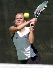 KU's Lauren Hommell makes a return during her doubles match Saturday morning as the 'Hawks hosted the Oklahoma Sooners.