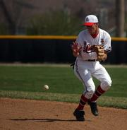 Lawrence High second baseman Nick Madl sets up to field a ground ball in the top of the sixth inning.