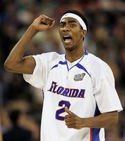 Florida's Corey Brewer cheers during the second half. Brewer scored 19 for the Gators.