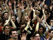 "Students raise their arms as they vote for a strike during a meeting of France&squot;s students unions Saturday in Lille, northern France. France&squot;s governing party called Saturday for dialogue with unions and students so that a bill modifying a much-contested youth labor law can be debated ""as soon as possible."""
