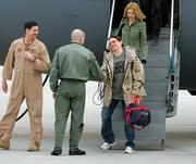 U.S. journalist Jill Carroll, right, leaves a C17 Globemaster and is welcomed by Base Commander Col. Kurt Lohide after she landed Saturday at the U.S. Airbase in Ramstein, Germany, Saturday. Carroll was a hostage in Iraq for 82 days and was released Thursday.