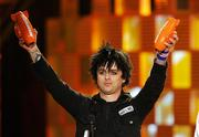 "Green Day lead singer Billie Joe Armstrong accepts awards for favorite music group and favorite song, ""Wake Me Up When September Ends,"" at the Kids&squot; Choice Awards on Saturday in Los Angeles. Winners were chosen by fans who voted online."