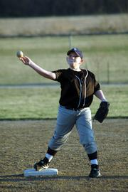 Joseph Mikesic, 11, makes a throw to first base from his second-base position during a practice with his baseball team at the YSI fields