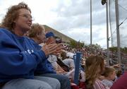Cheryl Wonnell claps and gives encouragement while Jayhawk batter Andy Scholl steps up to the plate in this 2005 file photo.