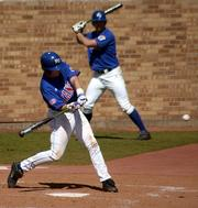 Senior first baseman Jared Schweitzer takes a home run swing during the bottom of the third inning. Schweitzer's fourth home run of the season gave the Jayhawks a 3-2 lead, which they held for a 9-6 victory against Missouri.