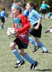 Blue Devil Goalie Addison Campbell runs the ball out for her teammates during Saturday's 10U Club division game against the Blue Phantoms. The Phantoms narrowly won 3-2.