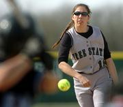 Free State senior pitcher Summer Mulford delivers to a Shawnee Mission East batter. The Firebirds swept a doubleheader against the Lancers on Tuesday at Free State.