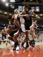 Duke's Alison Bales defends against Maryland's Jade Perry, left, and Laura Harper, right. Maryland edged Duke, 78-75 in overtime, Tuesday in Boston for the NCAA championship. Harper earned tournament MVP honors.