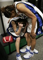 Duke's Monique Currie, right, consoles Abby Waner in the locker room. The Blue Devils lost the NCAA Tournament finals to Maryland, 78-75, Tuesday in Boston.