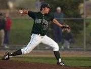 Free State senior Scott Heithusen unloads a pitch late in the game. Heithusen came on in relief after a short rain delay, but lost 4-6 against Shawnee Mission North Thursday at FSHS.