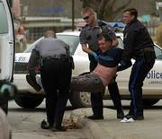 "Lawrence Police officers arrest Robert ""Simon"" Gilmore at Seventh and New Hampshire streets in this Dec. 30, 2005, file photo after fielding several calls about him walking in the streets. The city of Lawrence says information about officers involved in complaints, the specific allegations they faced, and how the cases were handled should not be public."