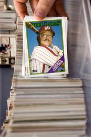 Kevin Mehan started his son Jack on the road to collecting about 1,000 baseball cards, April 4, 2006, in Yardley, Pennsylvania.