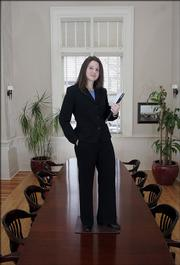 Audrey Huston, a KU graduate student in accounting,  models a business suit at the News Center, 645 N.H.