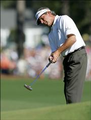 Fred Couples makes his eagle attempt on the eighth green during final round play of the Masters golf tournament at the Augusta National Golf Club in Augusta, Ga., Sunday, April 9, 2006.