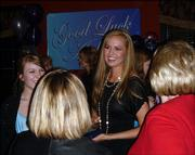 Ashley Aull, Miss Kansas USA 2006, greets well-wishers at a surprise sendoff at The Overlook restaurant in Lansing. Aull, who lives in Lansing, left April 2 for Baltimore to compete in this year's Miss USA pageant, which will be televised April 21.