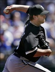 White Sox pitcher Mark Buehrle pitches to Royals lead-off batter Tony Graffanino. Buehrle pitched eight shutout innings in Chicago's 3-1 victory Sunday in Kansas City, Mo.