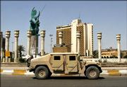 "U.S. soldiers in a Humvee patrol past the sculpture nicknamed ""Freedom,"" which was put up to replace the statue of Saddam Hussein pulled down by three years ago Sunday in Baghdad, Iraq. Three years after the statue came down, symbolizing the defeat of Saddam Hussein&squot;s regime, Iraqi politicians were scheduling meetings to try to resolve the deadlock over who will be the country&squot;s next prime minister. The new statue features an angelic woman holding up a sicklelike moon symbolizing Islam and a Sumerian sun as an emblem of Iraqi national pride."