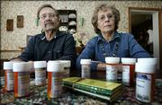 Max and Donna Dougherty are shown in their Bedford, Iowa, home with the prescription medications that Max takes. The Doughertys are pleased with the new Medicare prescription program, saying it saves them up to $350 a month.