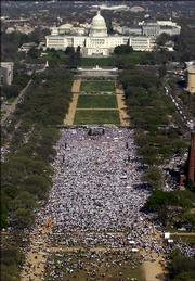 Supporters for immigration rights gather for a rally on the National Mall, Monday, April 10, 2006 in Washington. Hundreds of thousands of people, demanding U.S. citizenship for illegal immigrants, took to the streets in dozens of cities Monday, in some of the most widespread demonstrations since the mass protests began around the country two weeks ago.