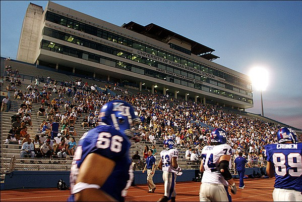 The Kansas football team is welcomed back to the field by a large crowd during a team scrimmage in 2006 at Memorial Stadium.