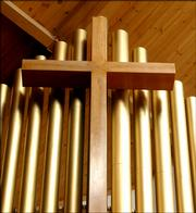 A cross rests in front of the Church's pipe organ at First Baptist Church, 1330 Kasold Drive.