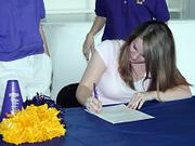 Amanda Howard signs a letter of intent to cheer at Kansas Wesleyan University on Friday at her gym, G-Force Athletics.