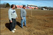 Alan Stumpff, left, and Brian Haselwood, workers for Precision Sports Fields,