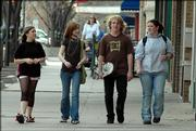 West Junior HIgh School students, from left, Krystle Iden, 14, Erin Sampson, 14, Cody Potter, 15, and Alyssa Myers, 14, walk along Massachusetts street. Students often can be found downtown on Wednesdays, which is an early-release day for Lawrence's junior high schools. The Ga Du Gi Safe Center, Liberty Hall, and other agencies and businesses are planning an after-school program for the students.
