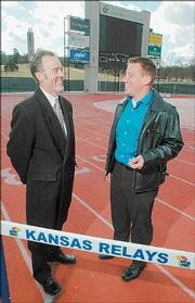 Mike Vickers, left, co-owner and vice president of Star Gameday, visits with Tim Weaver, meet director for Kansas Relays, at Memorial Stadium in this January 2006 file photo. Star Gameday is handling the sponsorships and advertising for the annual spring event.