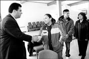 Ryan Wilson, left, president of the National Indian Education Assn., greets Alexis Mendez, a Haskell Indian Nations University junior from Fort Ducheson, Utah, at a school gathering in January. Wilson urged the university to lobby lawmakers about federal funding issues during his visit.