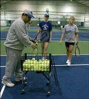 Frank Polito, assistant coach of the Kansas University women's tennis team, instructs Liza Avdeeva and Ksenia Bukina at First Serve, 5200 Clinton Parkway. The facility used to be part of Sport 2 Sport but now is a tennis venue.
