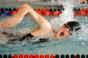 Lawrence High's Eva Wehrle swims in the 50-yard freestyle. The Lions won a meet Tuesday in Knox Natatorium.