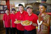 From left, Thai-Siam employees Amporn Duangmala, Urat Chaisri, and owners Jeab and Dustin Srisutiva serve Thai cuisine at their popular restaurant at Sixth Street and Kasold Drive.
