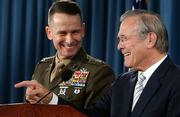 Defense Secretary Donald Rumsfeld, right, accompanied by Joint Chiefs Chairman Gen. Peter Pace, answers a reporter's question during a news conference at the Pentagon. Rumsfeld said Tuesday he hasn't considered resigning despite calls for him to do so by a half-dozen retired generals.