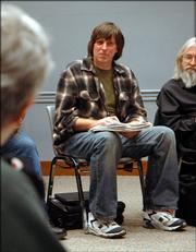 Steve Ozark, InterFaith Initiative coordinator, participates in a homeless coalition meeting at the Lawrence Public Library, 707 Vt. Ozark founded the InterFaith Initiative, which has participants from 45 faith groups in Lawrence.