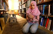 Kansas University junior Bazigha Tufail prays in the Spahr Engineering Library on Wednesday after her 1 p.m. structural engineering class. The Muslim student prays five times a day and often feels misunderstood by other students.