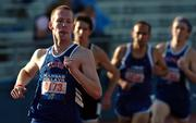 Kansas University's Adrian Ludwig comes around the bend during the men's 1,500-meter run.