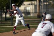 Lawrence High junior pitcher Daniel Green tries to pick off a runner at first base. LHS played Olathe East Thursday at Ice Field.