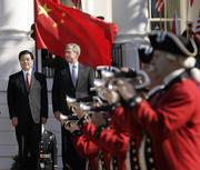 Chinese President Hu Jintao, left, is greeted by President Bush and a traditional U.S. military honor guard in colonial dress during a ceremony on the South Lawn of the White House. The two leaders met Thursday but had little tangible to show for a meeting marred by protest.