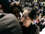A Secret Service agent covers the mouth of Wenyi Wang, 47,  after she disrupted the speech of Chinese President Hu Jintao.
