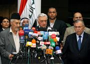 Iraqi political parties agreed to postpone their scheduled parliament session until Saturday after Prime Minister Ibrahim al-Jaafari cleared the way for Shiite leaders to withdraw his nomination for a second term. From left, Iraqi Sunni politician Adnan al-Dulaimi, Parliament Speaker Adnan Pachachi and Iraqi President Jalal Talabani announced the postponement Thursday in Baghdad, Iraq.