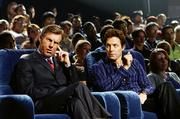 "The President (Dennis Quaid), left, suffers an untimely earpiece malfunction while judging a TV show run by Martin Tweed (Hugh Grant), in ""American Dreamz."""