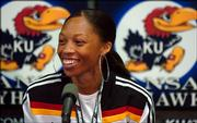 Sprinter Allyson Felix smiles as she answers questions Friday afternoon during a press conference at Memorial Stadium.