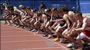 Runners in the boy's 3200 race await the sound of the gun at the Kansas Relays on Friday at Memorial Stadium.