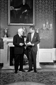 President John F. Kennedy and poet Robert Frost chat in the green room of the White House under a portrait of John Quincy Adams.  The 85-year-old poet who delivered one of his own works at Kennedy's inauguration, was the first scheduled visitor on January 22, 1961 to the White House. The John F. Kennedy Library and Museum has obtained the original version of the poem that Frost prepared for the inauguration of John F. Kennedy, but never read in its entirety because of the glare of the sun.
